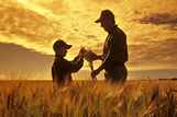 Father and son in a maturing barley field